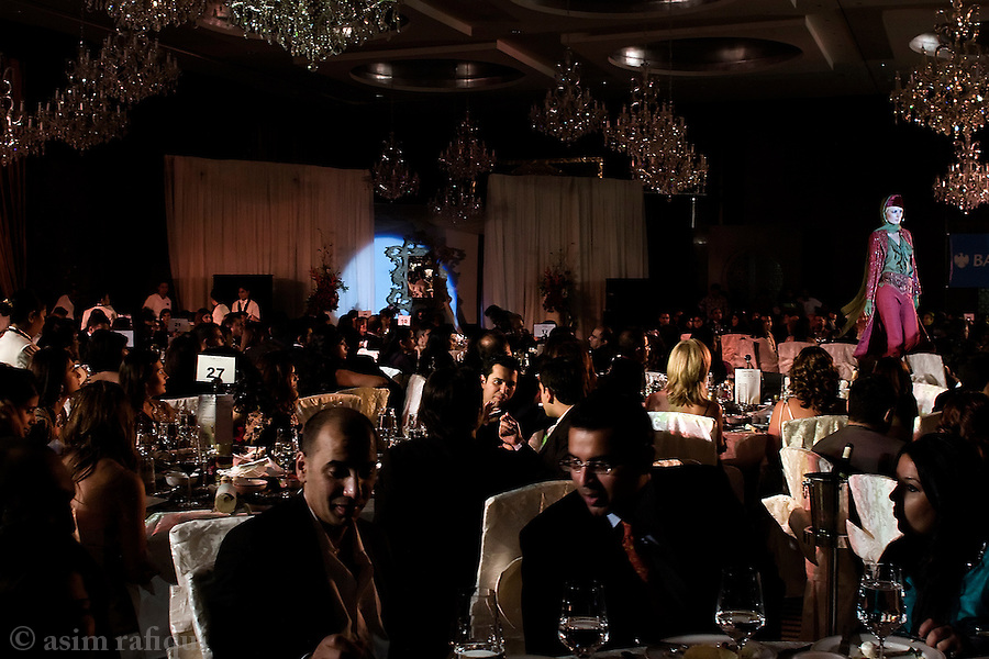 Members of Pakistan's elite at a charity dinner and fashion show in Dubai, UAE.