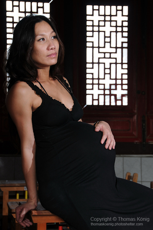Kaohsiung, Taiwan -- Pregnant model at the Confucius Temple in Kaohsiung.