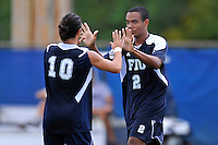 10 September 2011:  FIU's Colby Burdette (2) celebrates his second-half goal with Lucas Di Croce (10) as the FIU Golden Panthers defeated the Stetson University Hatters, 3-2 in the second overtime period, at University Park Stadium in Miami, Florida.