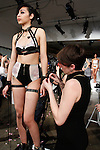 "Fashion designer Dani Read restrains model during her FYI by Dani Read Spring 2014 ""The Muse of the Violets"" lingerie collection fashion presentation, during Lingerie Fashion Week Fall Winter 2014, on February 21, 2014."