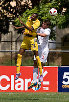 Daniel Stanese (5) of Canda goes up for a header against Zari Prescod (17) of Barbados during the group stage of the CONCACAF Men's Under 17 Championship at Jarrett Park in Montego Bay, Jamaica. Costa Rica defeated El Salvador, 3-2.