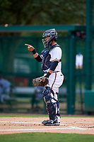 GCL Braves catcher Victor De Hoyos (2) signals to the defense during the second game of a doubleheader against the GCL Yankees West on July 30, 2018 at Champion Stadium in Kissimmee, Florida.  GCL Braves defeated GCL Yankees West 5-4.  (Mike Janes/Four Seam Images)