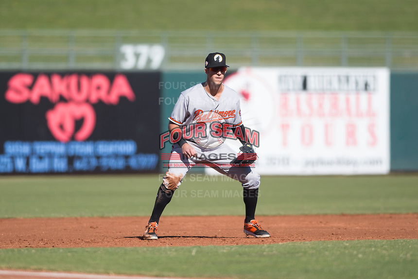 Glendale Desert Dogs third baseman Steve Wilkerson (12), of the Baltimore Orioles organization, during an Arizona Fall League game against the Surprise Saguaros at Surprise Stadium on November 13, 2018 in Surprise, Arizona. Surprise defeated Glendale 9-2. (Zachary Lucy/Four Seam Images)