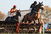 Showmanship ridden by Jack Quinlan in jumping action during the Hempton National Hunt Maiden Hurdle