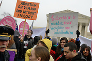 January 23, 2012  (Washington, DC)  Pro-choice supporters hold signs in front of the U.S. Supreme Court during the annual March For Life and rally held on the National Mall in Washington.   (Photo by Don Baxter/Media Images International)