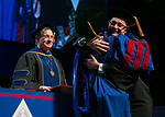 Gerald P. Koocher, dean of the College of Science and Health, watches as the doctoral recipients receive their hoods Sunday, June 11, 2017, during the DePaul University College of Science and Health and College of Liberal Arts and Social Sciences commencement ceremony at the Allstate Arena in Rosemont, IL. (DePaul University/Jamie Moncrief)