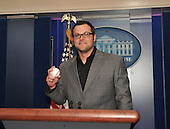 Washington, DC - April 7, 2009 -- New York Yankees pitcher Joba Chamberlain (62) pauses for a photo at the podium where Robert Gibbs gives his daily press briefing at the White House in Washington, DC on Tuesday, April 7, 2009..Credit: Ron Sachs / CNP.(RESTRICTION: NO New York or New Jersey Newspapers or newspapers within a 75 mile radius of New York City)