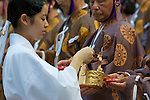 August 17th, 2011- Mishima, Shizuoka, Japan-. A Shrine attendent waits to pour ceremonial rice wine at the closing ceremony of a Yabusame ritual held at Mishima Taisha Shrine.