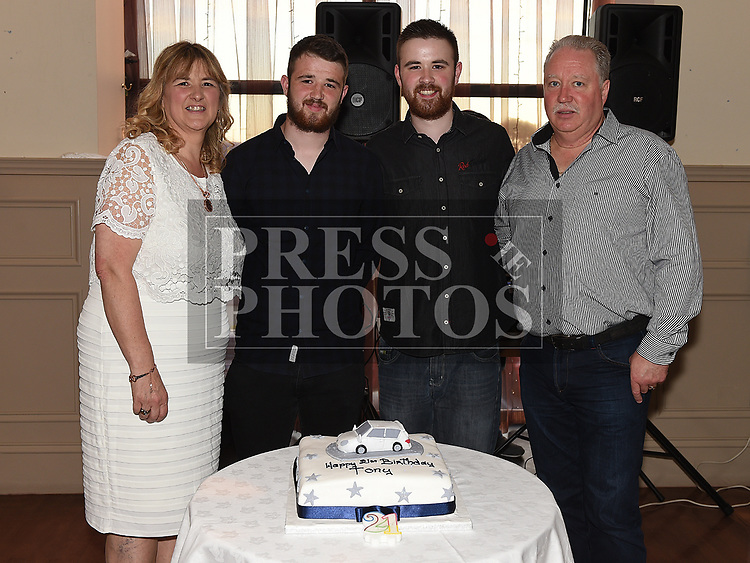 Tony O'Hare celebrating his 21st birthday with parents Paul and Rita and brother Vinnie in the Thatch. Photo:Colin Bell/pressphotos.ie