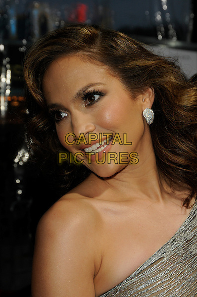"JENNIFER LOPEZ .arriving at the premiere of CBS Films' ""The Back-up Plan"" at the Regency Village Theatre in Westwood, California, USA, April 21st, 2010..arrivals portrait headshot one shoulder silver earring wavy hair  profile smiling .CAP/ROT.©Lee Roth/Capital Pictures"