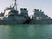 ADEN, Yemen (October 12, 2000) -- Port side view showing the damage sustained by the Arleigh Burke class guided missile destroyer USS Cole (DDG 67) after a suspected terrorist bomb exploded during a refueling operation in the port of Aden.  USS Cole is on a regular scheduled six-month deployment.  <br /> Credit: DOD / CNP