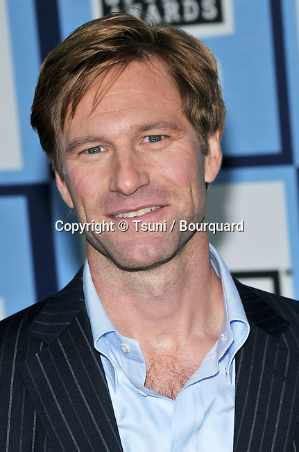 Aaron Eckhart  AT THE ISP - INDEPENDENT SPIRIT AWARDS - on the Beach in Santa Monica.<br /> <br /> headshot<br /> eye contact<br /> smile