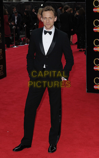 Tom Hiddleston.The Laurence Olivier Awards held at the Royal Opera House - Arrivals, London, England..April 28th, 013.full length black white bow tie tuxedo hands in pockets .CAP/CAN.©Can Nguyen/Capital Pictures.