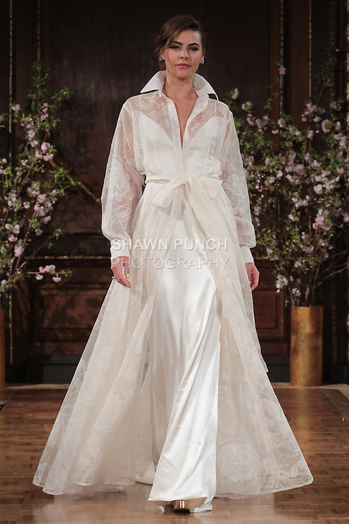 "Model walks runway in a ""Drew"" bridal gown from the Isabelle Armstrong Spring Collection 2017, at Lotte New York Palace Hotel, during New York Bridal Fashion Week Spring Summer 2017 on April 16, 2017."