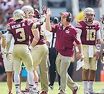 Florida State head coach Jimbo Fisher gives a high five to wide receiver Jesus Wilson after Wilson made a first down in the first half of an NCAA college football game against Syracuse in Tallahassee, Fla., Saturday, Oct. 31, 2015.  Florida State defeated Syracuse 45-21.  (AP Photo/Mark Wallheiser)