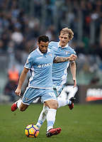 Calcio, Serie A: Lazio vs Roma. Roma, stadio Olimpico, 4 dicembre 2016.<br /> Lazio's Felipe Anderson, left, kicks the ball past his teammate Dusan Basta during the Italian Serie A football match between Lazio and Rome at Rome's Olympic stadium, 4 December 2016. Roma won 2-0.<br /> UPDATE IMAGES PRESS/Isabella Bonotto