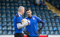 Goalkeeper Scott Shearer of Mansfield Town chats to Goalkeeper Brian Jensen of Mansfield Town during pre warm up during the Sky Bet League 2 match between Wycombe Wanderers and Mansfield Town at Adams Park, High Wycombe, England on 25 March 2016. Photo by Andy Rowland.
