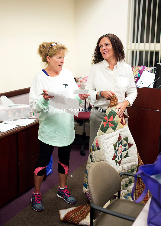 Waterbury, CT- 21 September 2015-092115CM11- ​<br /> Tess Cook of Watertown, left, and Deborah Van Steenbergen of Watertown and founder of Quilts that Care  share a laugh inside the Harold Leever Regional Cancer Center in Waterbury on Monday.    Christopher Massa Republican-American