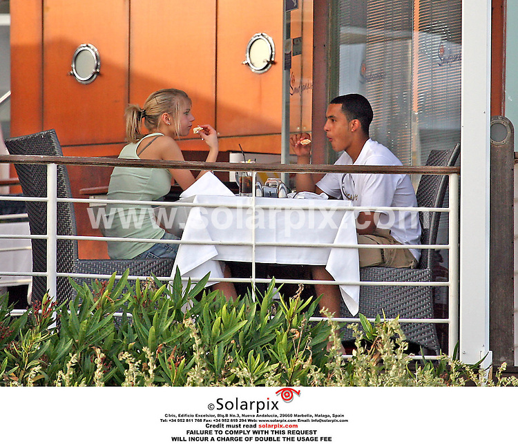 ALL-ROUND PICTURES FROM SOLARPIX.COM .*MUST CREDIT SOLARPIX.COM OR DOUBLE FEE WILL BE CHARGED*.Arsenal and England wonder kid Theo Walcott entertains his girlfriend Melanie Slade at a beachside restaurant on the Algarve in Portugal where they are for a one week pre World Cup break with the England football squad..       .DATE:16.05.06-JOB REF:2365-AB1