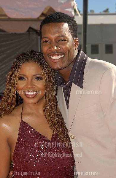 FLEX ALEXANDER & wife at the 9th Annual Soul Train Lady of Soul Awards in Pasadena, CA..Aug 23, 2003