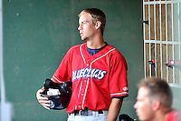 Left fielder Zachary Coppola (2) of the Lakewood BlueClaws waits in the dugout for his turn at bat in a game against the Greenville Drive on Thursday, June 23, 2016, at Fluor Field at the West End in Greenville, South Carolina. Lakewood won, 8-7. (Tom Priddy/Four Seam Images)