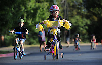 NWA Democrat-Gazette/ANDY SHUPE<br /> Allie Jo Bunch, 4, rides her bicycle Wednesday, Sept. 23, 2015, during the first day of the annual First School Trike Rally at First United Presbyterian Church in Fayetteville. The event, which serves as a fundraiser for St. Jude's Children's Hospital, features bike riding, temporary tattoos, snow cones, a bike wash and demonstrations from the Fayetteville Police Department. Visit nwadg.com/photos to see more photographs from the morning.