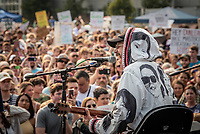 John Gourley of Grammy-winning Alaskan rock band Portugal. The Man as they perform at a rally to override the governor's vetoes at the Alaska Airlines Center.