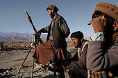 Bagram, Afghanistan<br /> November 19, 2001<br /> <br /> Northern Alliance soldiers hold a check point along the road leading from Kabul to the Bagram airport. This was the front line between the Northern Alliance and the Taliban.