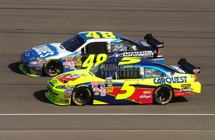 Oct. 11, 2009; Fontana, CA, USA; NASCAR Sprint Cup Series driver Jimmie Johnson (48) races alongside Mark Martin (5) during the Pepsi 500 at Auto Club Speedway. Mandatory Credit: Mark J. Rebilas-
