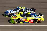 Oct. 11, 2009; Fontana, CA, USA; NASCAR Sprint Cup Series driver Jimmie Johnson (48) races alongside Mark Martin (5) during the Pepsi 500 at Auto Club Speedway. Mandatory Credit: Mark J. Rebilas-