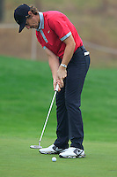 Tommy Fleetwood (ENG) putts on the 1st green during Thursday's Round 1 of the 2014 BMW Masters held at Lake Malaren, Shanghai, China 30th October 2014.<br /> Picture: Eoin Clarke www.golffile.ie