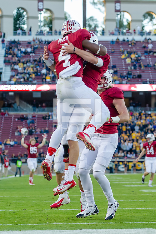 STANFORD, CA - NOVEMBER 23, 2013: Francis Owusu celebrates a touchdown with teammates during Stanford's game against Cal. The Cardinal defeated the Bears 63-13.