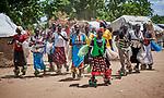 Women dance to celebrate a wedding in Bunj, South Sudan.