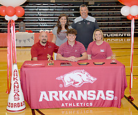 Graham Thomas/Siloam Sunday<br /> Siloam Springs senior Kaiden Thrailkill signed a letter of intent Wednesday to join the University of Arkansas cheerleading team. Pictured are: Front from left, father Mark Thrailkill, Kaiden Thrailkill, mother Rachael Thrailkill; back, Siloam Springs cheer coach Jackie Clement and football coach Brandon Craig.