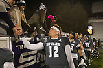 Nevada quarterback Carson Strong (12) and his team meet fans after an NCAA college football game against New Mexico in Reno, Nev., Saturday, Nov. 2, 2019. (AP Photo/Tom R. Smedes)