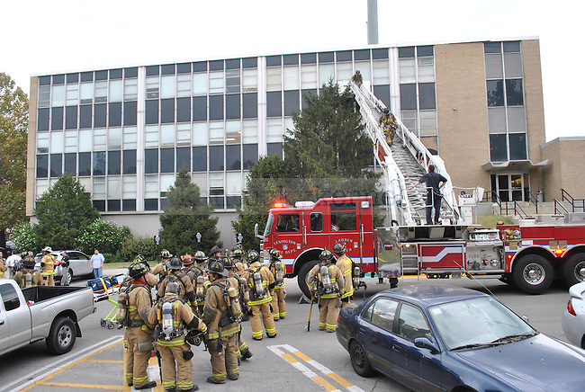 Firefighters work together to put out the Chem-phys fire September 7.
