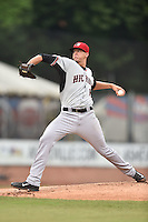 Hickory Crawdads starting pitcher Brett Martin (10) delivers a pitch during a game against the Asheville Tourists on July 23, 2015 in Asheville, North Carolina. The Crawdads defeated the Tourists 8-6. (Tony Farlow/Four Seam Images)