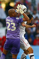 Rais M'Bolhi (23) of Algeria saves under pressure from Landon Donovan (right) of USA. USA defeated Algeria 1-0 in stoppage time in the 2010 FIFA World Cup at Loftus Versfeld Stadium in Pretoria, Sourth Africa, on June 23th, 2010.