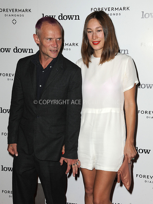 ACEPIXS.COM<br /> <br /> October 23 2014, LA<br /> <br /> Flea and Sandha Khin arriving at the premiere of 'Lowdown' at the ArcLight Hollywood on October 23, 2014 in Hollywood, California<br /> <br /> By Line: Peter West/ACE Pictures<br /> <br /> ACE Pictures, Inc.<br /> www.acepixs.com<br /> Email: info@acepixs.com<br /> Tel: 646 769 0430