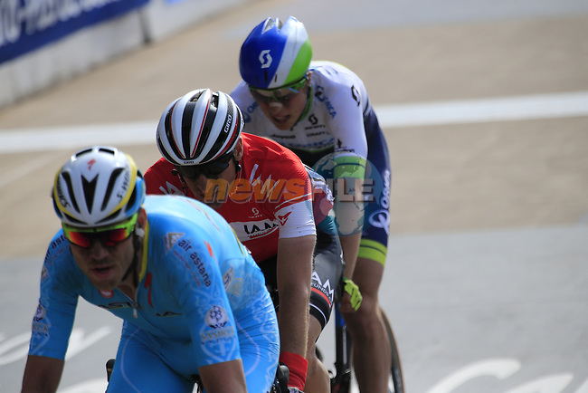 The lead group of riders including Lars Boom (NED) Astana, Martin Elmiger (SUI) IAM Cycling and Jens Keukeleire (BEL) Orica GreenEdge enter the famous Roubaix Velodrome at the end of the 113th edition of the Paris-Roubaix 2015 cycle race held over the cobbled roads of Northern France. 12th April 2015.<br /> Photo: Eoin Clarke www.newsfile.ie
