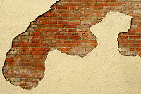 Bricks showing through a plastered wall of a building in Bellingham, Washington, USA....