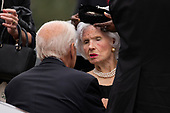 Former United States Vice President Joe Biden speaks with  the mother of late US Senator John McCain (Republican of Arizona) Roberta McCain prior to a funeral service for the Senator at the Washington National Cathedral in Washington, DC on September 1, 2018. <br /> Credit: Alex Edelman / CNP