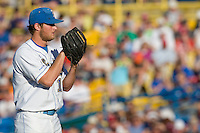 UCLA starting pitcher Gerrit Cole prepares to deliver a pitch during Game One of the NCAA Division One Men's College World Series Finals on June 28th, 2010 at Johnny Rosenblatt Stadium in Omaha, Nebraska.  (Photo by Andrew Woolley / Four Seam Images)