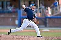 Asheville Tourists pitcher Jerad McCrummen (26) delivers a pitch during a game against the Charleston RiverDogs on June 13, 2015 in Asheville, North Carolina. The Tourists defeated the RiverDogs 10-6. (Tony Farlow/Four Seam Images)