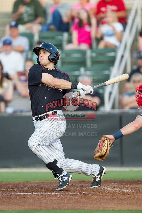 Jacob Morris (24) of the Kannapolis Intimidators follows through on his swing against the Hagerstown Suns at CMC-Northeast Stadium on May 31, 2014 in Kannapolis, North Carolina.  The Intimidators defeated the Suns 4-3 in game two of a double-header.  (Brian Westerholt/Four Seam Images)