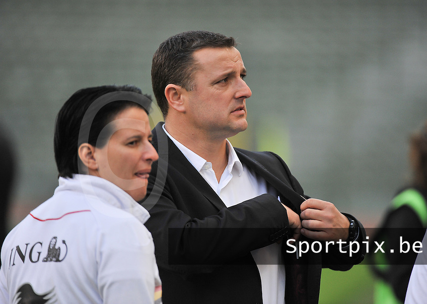 20130921 - BRUSSELS , BELGIUM : Belgian Coach Ives Serneels (right) pictured with assistant coach Tamara Cassimon (left)during the female soccer match between Belgium and Albania , on the first matchday in group 5 of the UEFA qualifying round to the FIFA Women World Cup in Canada 2015 at the Koning Boudewijn Stadion , Brussels . Saturday 21th September 2013. PHOTO DAVID CATRY