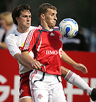 28 March 2007: Toronto's Ronnie O'Brien (right) looks to settle the ball against the defense of New York's Todd Dunivant (left). Toronto FC defeated the New York Red Bulls 2-1 at Blackbaud Stadium in Cary, North Carolina in the 2007 Carolina Challenge Cup.