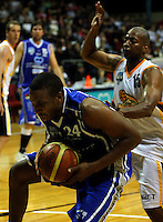 Ernest Scott catches the ball under pressure from Link Abrams during the NBL Basketball match between Wellington Saints and Devon Dynamos Taranaki at TSB Bank Arena, Wellington, New Zealand on Friday, 11 April 2008. Photo: Dave Lintott / lintottphoto.co.nz