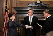 Elena Kagan is sworn in as the Supreme Court's newest member as Chief Justice John Roberts, right, administers the judicial oath, at the Supreme Court Building in Washington, Saturday, August 7, 2010. The Bible is held by Jeffrey Minear, center, counselor to the chief justice. Kagan, 50, who replaces retired Justice John Paul Stevens, becomes the fourth woman to sit on the high court and is the first Supreme Court justice in nearly four decades with no previous experience as a judge. .Mandatory Credit: J. Scott Applewhite - Pool via CNP
