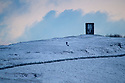 08/12/17<br /> <br /> A dog walker goes fro a dawn walk near Grinlow Tower (also know as Solomon's Temple), Buxton, after overnight snowfall in the Derbyshire Peak District.<br />   <br /> All Rights Reserved F Stop Press Ltd. +44 (0)1335 344240 +44 (0)7765 242650  www.fstoppress.com